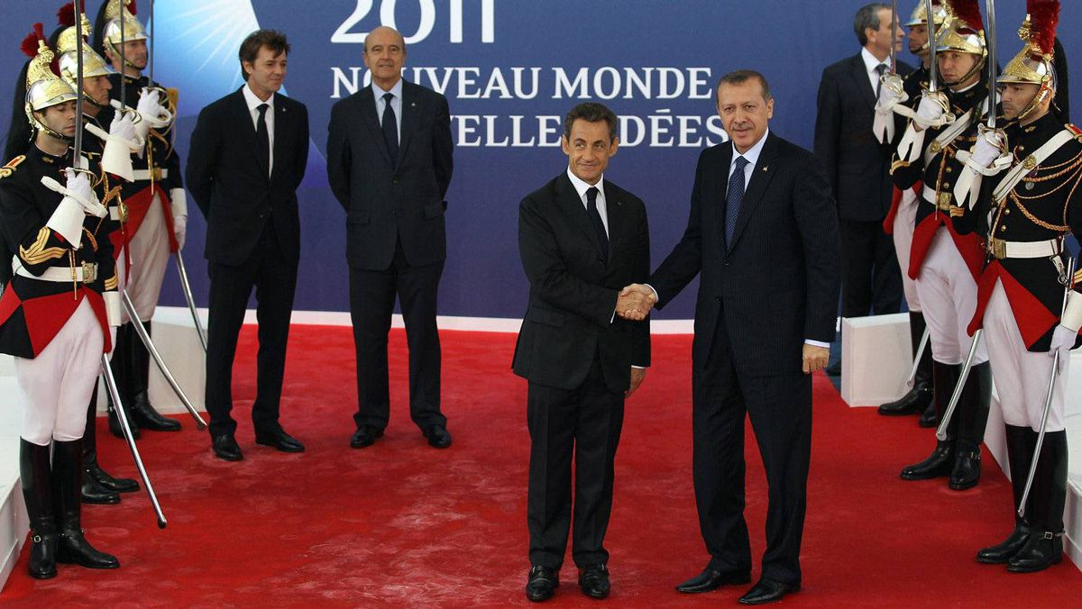 Turkish Prime Minister Recep Tayyip Erdogan is welcomed to the G20 summit by Sarkozy.