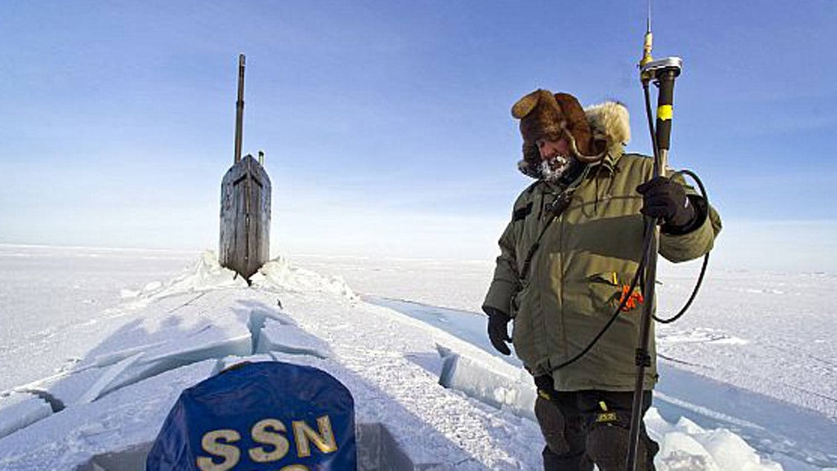 Hector Castillo watches daily operations while communicating with the command hut at the Applied Physics Lab Ice Station as the Seawolf-class attack submarine USS Connecticut (SSN 22) prepares to submerge under the ice during ICEX 2011.