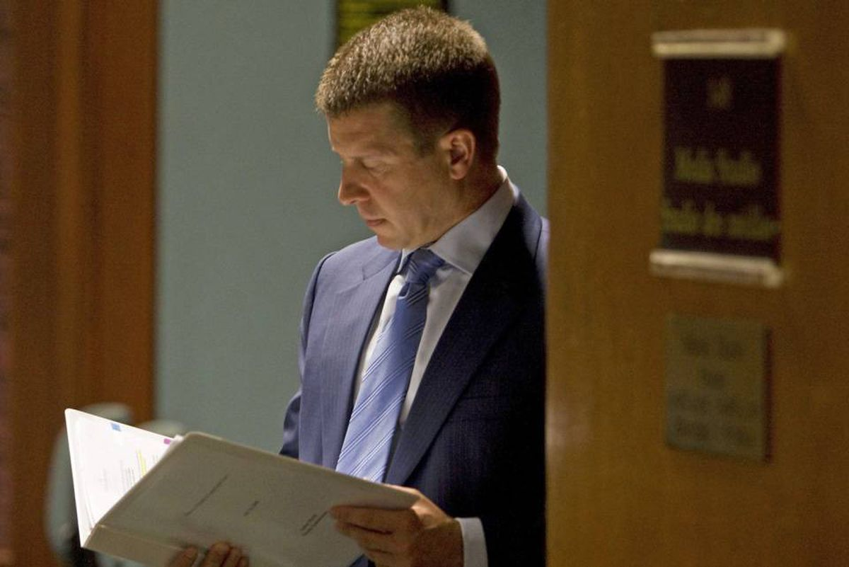 Ontario ombudsman Andre Marin reviews his notes after a news conference in Toronto on July 16, 2008.