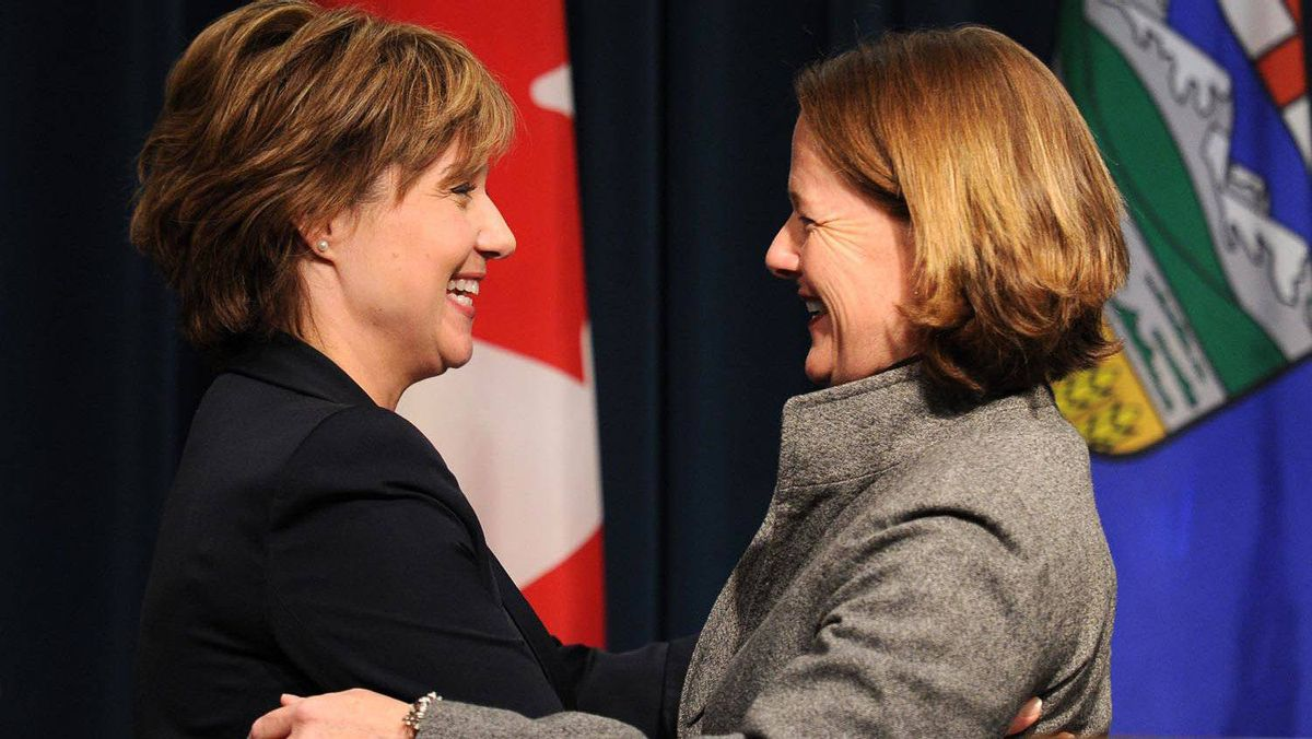 B.C. Premier Christy Clark, left, and Alberta Premier Alison Redford embrace after a joint press conference in Calgary on Oct. 21, 2011.