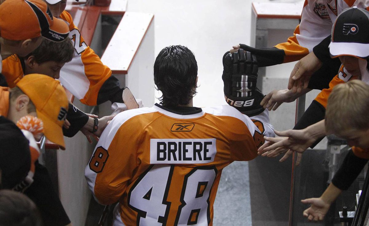 Philadelphia Flyers center Danny Brière slaps hands with fans as he enters the rink to warm up before Game 6 of the NHL Stanley Cup. (AP Photo/Matt Slocum)