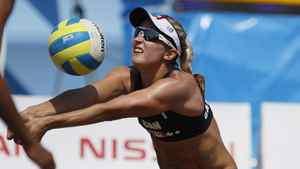 Canada's Heather Bansley sets the ball in a women's beach volleyball quarterfinal match against Brazil at the Pan American Games in Puerto Vallarta, Mexico, Wednesday Oct. 19, 2011. Brazil won 2-0.