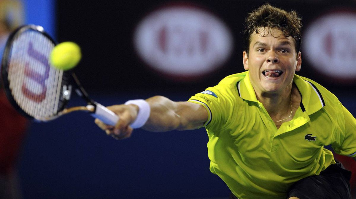 Canada's Milos Raonic hits a return to Australia's Lleyton Hewitt during their third round match at the Australian Open tennis championship, in Melbourne, Australia, Saturday, Jan. 21, 2012.