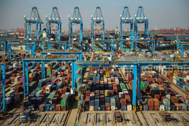 China to cut tariffs on goods including pork, tech items