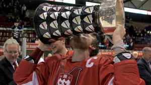 McGill Redmen team captain Evan Vossen kisses the University Cup after his team beat the Western Mustangs to win the 2012 CIS men's ice hockey championship on Sunday, March 25, 2012 in Fredericton, New Brunswick. McGill won the game 4-3 in OT, with Vossen scoring the game winner. THE CANADIAN PRESS/Mike Dembeck.