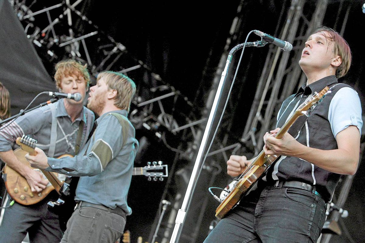 Edwin Farnham Butler III, right, leads Arcade Fire during a performance in Nyon, Switzerland.