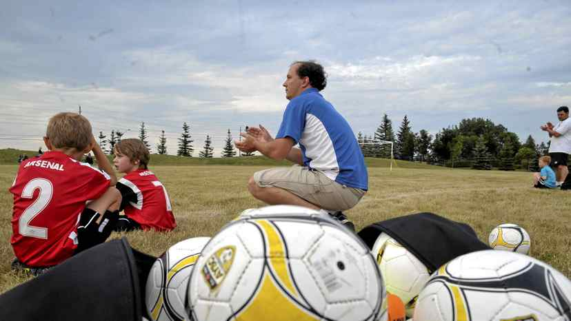 Coach David Hilgendorff allowed clapping from the sidelines, but not cheering or yelling, at Wednesday's game of the Aurora Youth Soccer house league in Aurora, Ont.