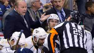 Nashville Predators head coach Barry Trotz, left, talks with referee Marc Joannette during the second period of game 1 of an NHL Western Conference semi-final Stanley Cup playoff hockey series against the Vancouver Canucks in Vancouver, B.C., on Thursday April 28, 2011.
