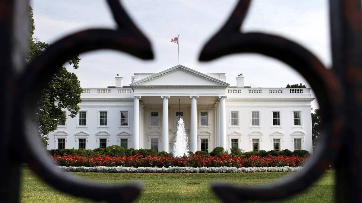 The White House is seen through the fence as debt talks continue in Washington, on Sunday, July 24, 2011.