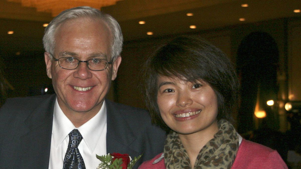 Xinhua News Agency journalist Shi Rong, shown with Conservative MP Bob Dechert, has returned home to China after 'flirtatious' e-mails sent to her by Mr. Dechert were made public.
