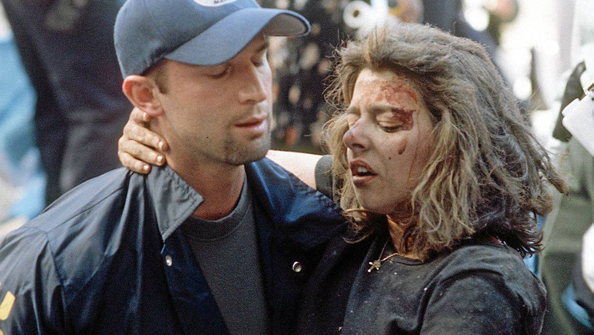 Deputy U.S. marshal Dominic Guadagnoli helps a women after she was injured in the terrorist attack on the World Trade Center in New York, Sept. 11, 2001. The Injured woman was later identified as Donna Spera.