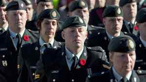 Members of the Canadian Forces wear poppies as they march during Remembrance Day ceremonies at the National War Memorial in Ottawa on Nov. 11, 2010.