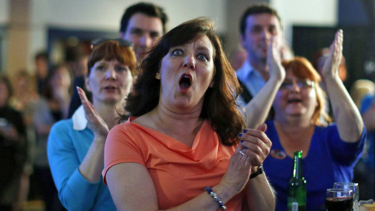 Progressive Conservative supporters cheer as they watch Alberta election results in Calgary on April 23, 2012.