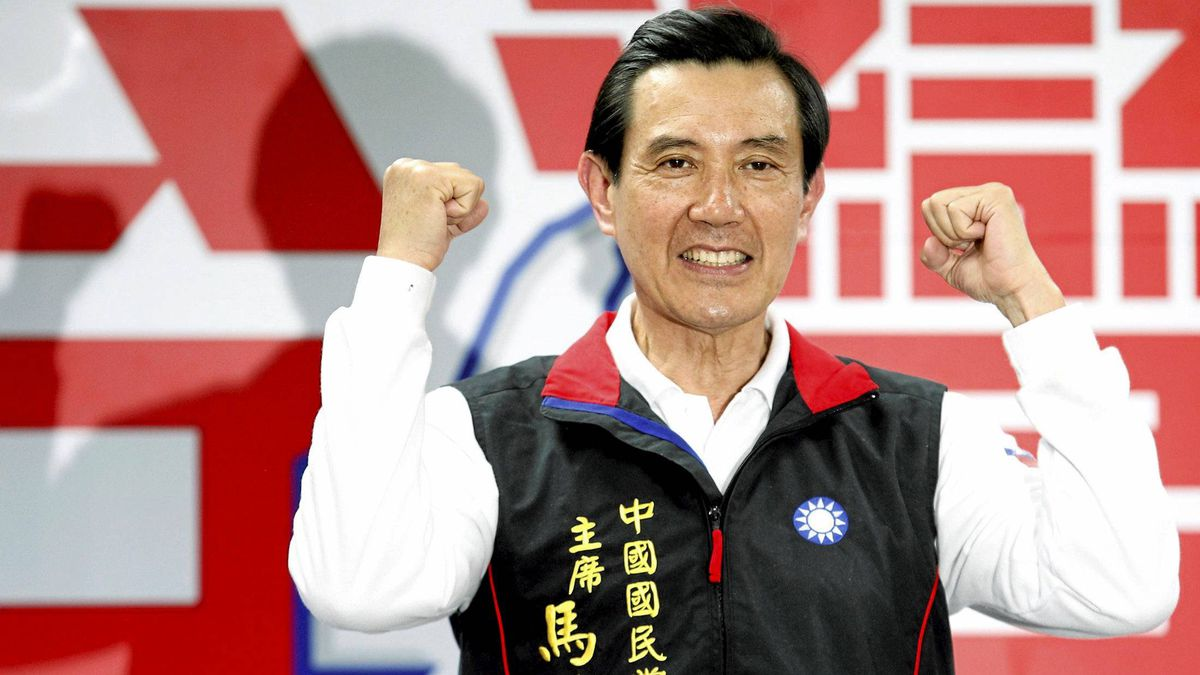 Taiwan's re-elected President Ma Ying-jeou gestures as he celebrates winning the 2012 presidential election with supporters in Taipei Jan. 15, 2012.