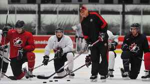 Canada's head coach Don Hay runs through drills in a practice the day after the team's crushing loss to the Russians.