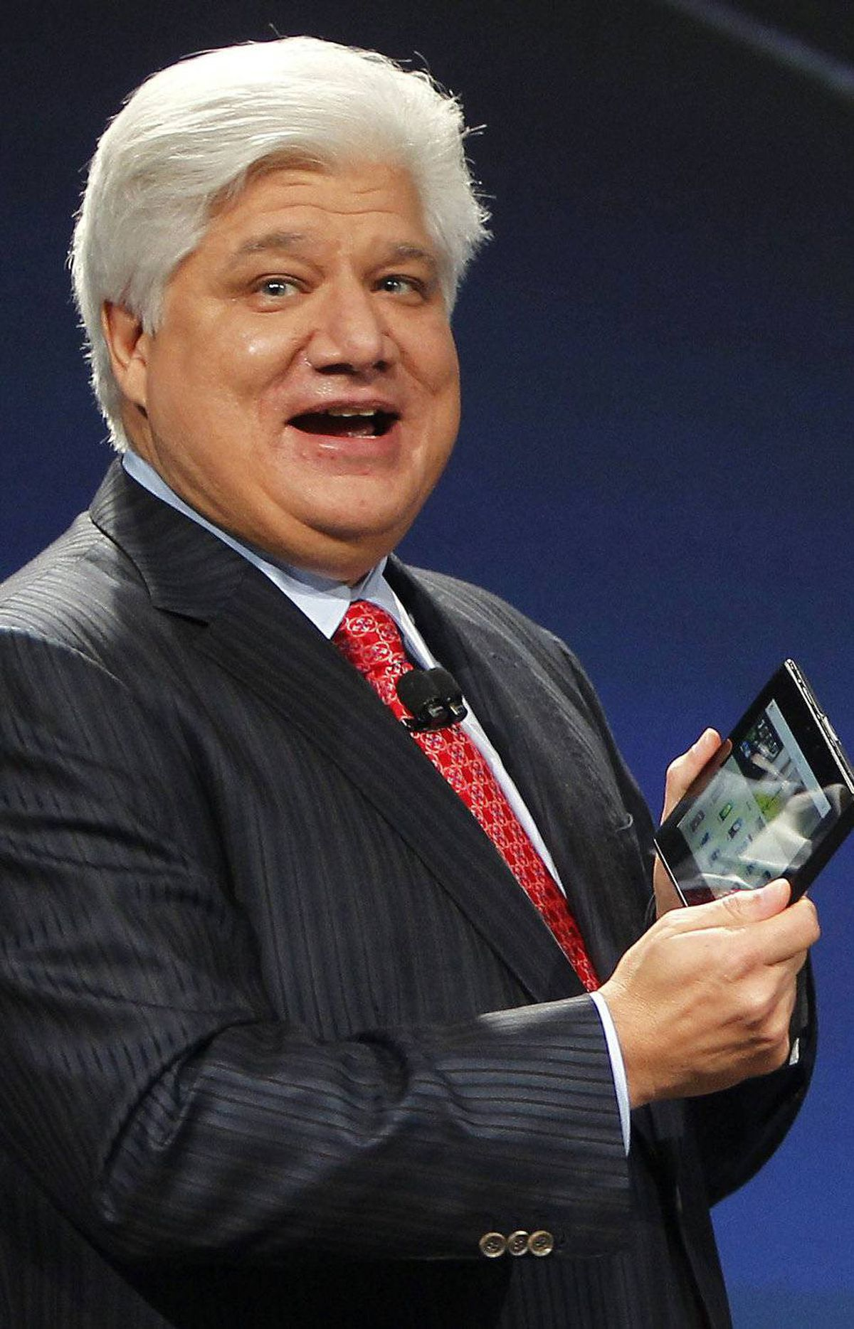 Mike Lazaridis, president and co-chief executive officer of Research in Motion, holds the new Blackberry PlayBook which is 9.7mm thin as he speaks at the RIM Blackberry developers conference in San Francisco, California September 27, 2010. REUTERS/Robert Galbraith (UNITED STATES - Tags: SCI TECH BUSINESS)