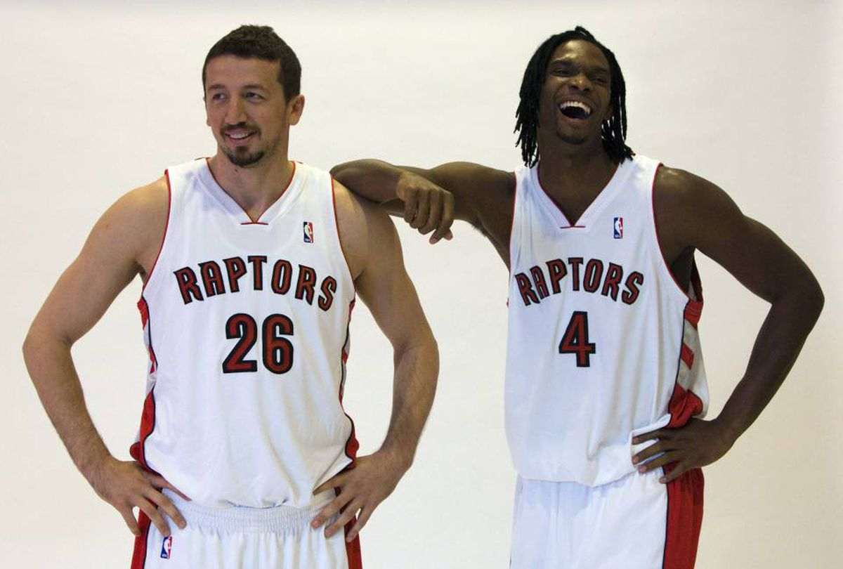 Toronto Raptors Chris Bosh (right) and Hedo Turkoglu laugh as they pose for a photo on Raptors Media Day in Toronto on Monday September 28, 2009. Turkoglu recently told a Turkish TV station that he is actively trying to be released from the Raptors.