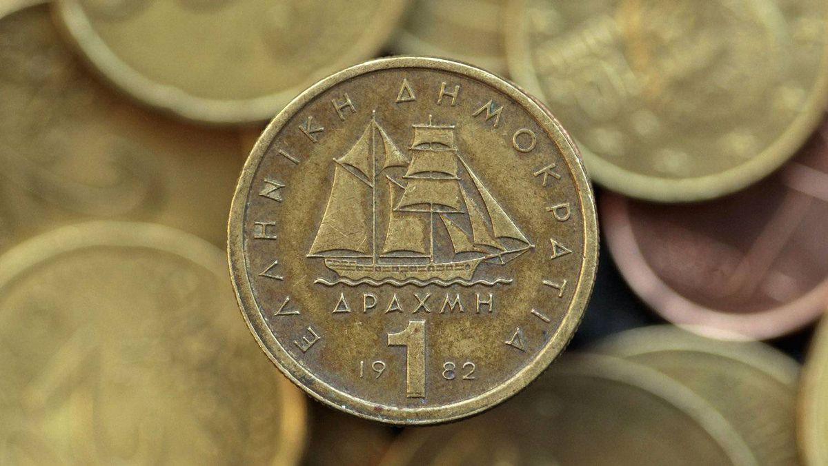 A drachma coin on display in this photo illustration taken in Athens, May 9, 2012. European policy makers are already preparing the ground for a Greek departure from the euro zone, insisting that the continent's financial safety net is now strong enough withstand the fallout. This is questionable. But it is by no means a foregone conclusion that the Greeks will leave – at least not yet.