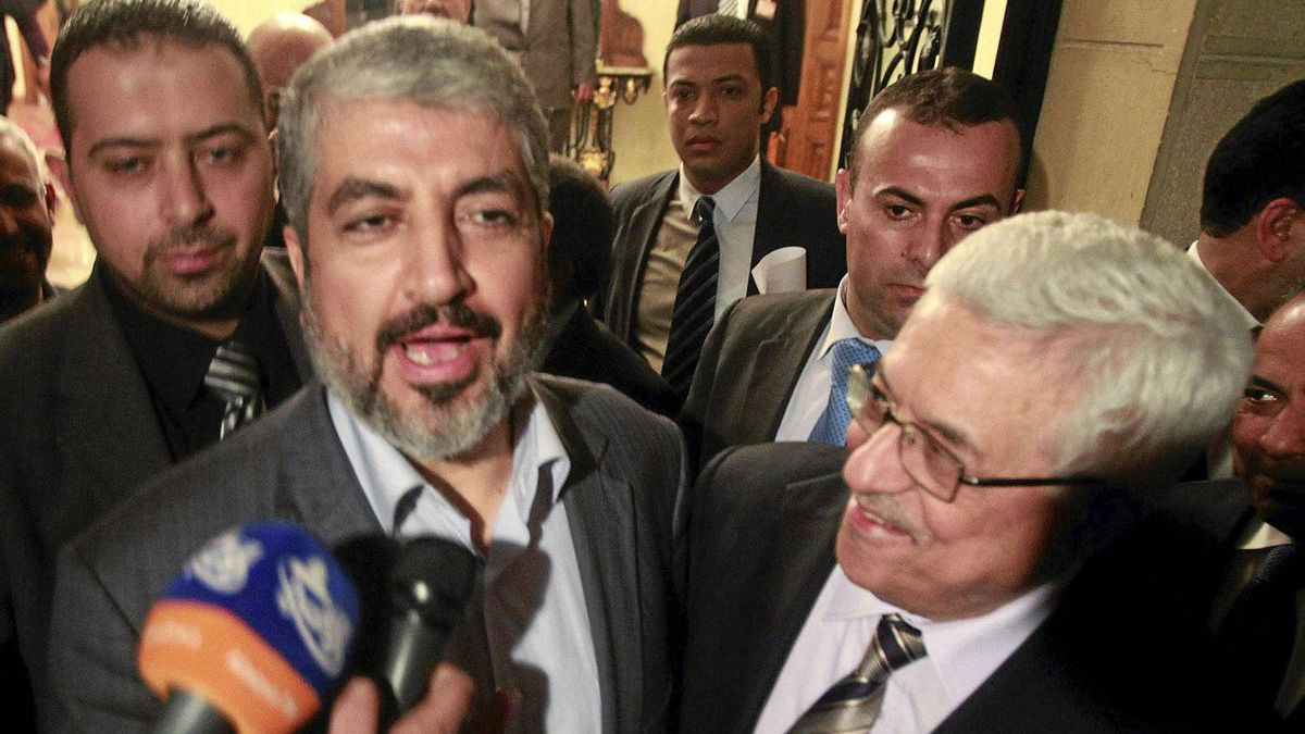 Hamas leader Khaled Meshaal, left, and Palestinian President Mahmoud Abbas speak to the media after their meeting in Cairo, Feb. 22, 2012.