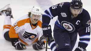 Winnipeg Jets' Andrew Ladd (16) skates around Philadelphia Flyers' Claude Giroux (28) during the second period of NHL action at MTS Centre in Winnipeg, Saturday, November 19, 2011. THE CANADIAN PRESS/Trevor Hagan