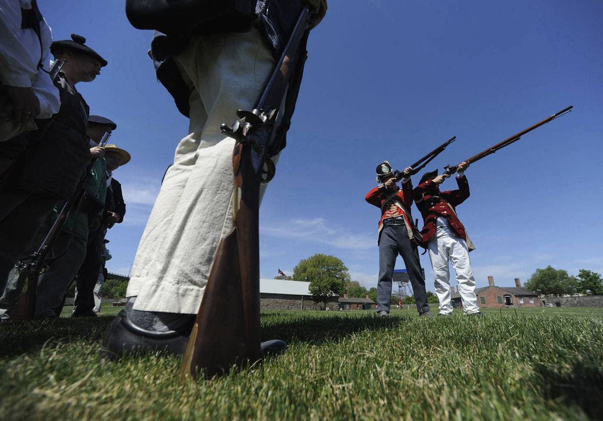 Len Heidebrecht (second from right) works with militia re-enactors during activities at Fort York on Victoria Day.