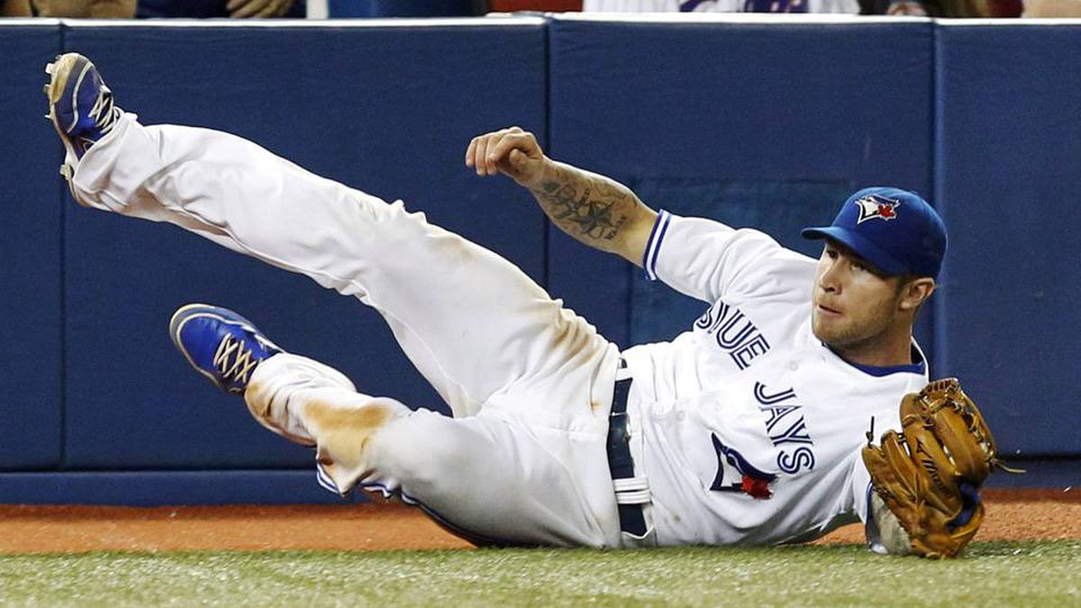 Toronto Blue Jays third baseman Brett Lawrie makes a diving catch against the Baltimore Orioles in foul territory during the ninth inning of their MLB American League baseball game in Toronto, May 29, 2012.
