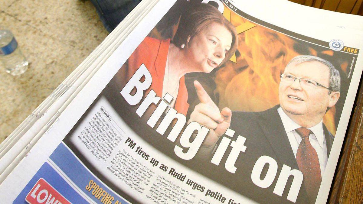 An Australian newspaper covers the political battle between Australian Prime Minister Julia Gillard, left, and former foreign minister Kevin Rudd, on Feb. 23, 2012.
