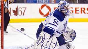 Toronto Maple Leafs goaltender Jonas Gustavsson makes a save on the New York Rangers during first period NHL hockey action in Toronto on Thursday October 21, 2010.