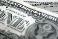 """A U.S. dollar bill, saying """"In God We Trust"""""""