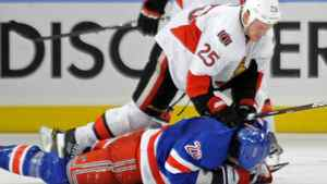 Ottawa Senators' Chris Neil (25) checks New York Rangers' Brian Boyle during the third period of Game 5 of an NHL Stanley Cup first-round hockey playoff series, Saturday, April 21, 2012, at New York's Madison Square Garden. The Senators won 2-0 to lead the series 3-2. (AP Photo/Bill Kostroun)