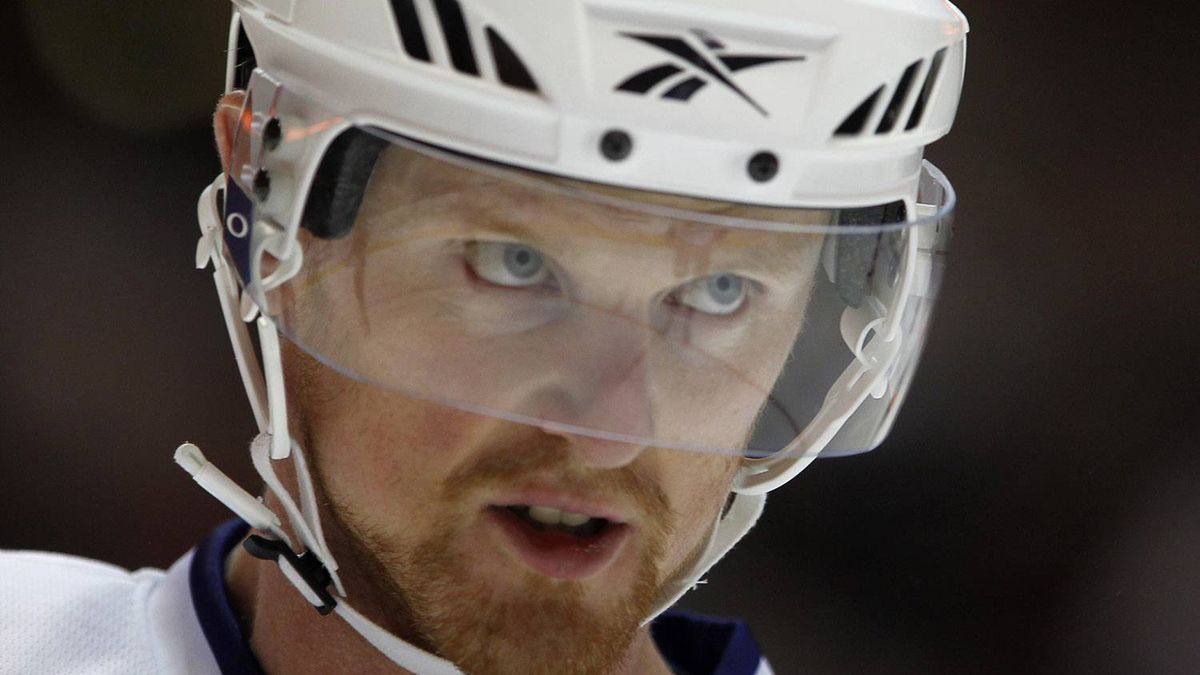 Vancouver Canucks center Henrik Sedin (33) looks out from behind his visor as he prepares to face off against the Anaheim Ducks during their preseason NHL hockey game in Anaheim, California October 1, 2010. REUTERS/Mike Blake