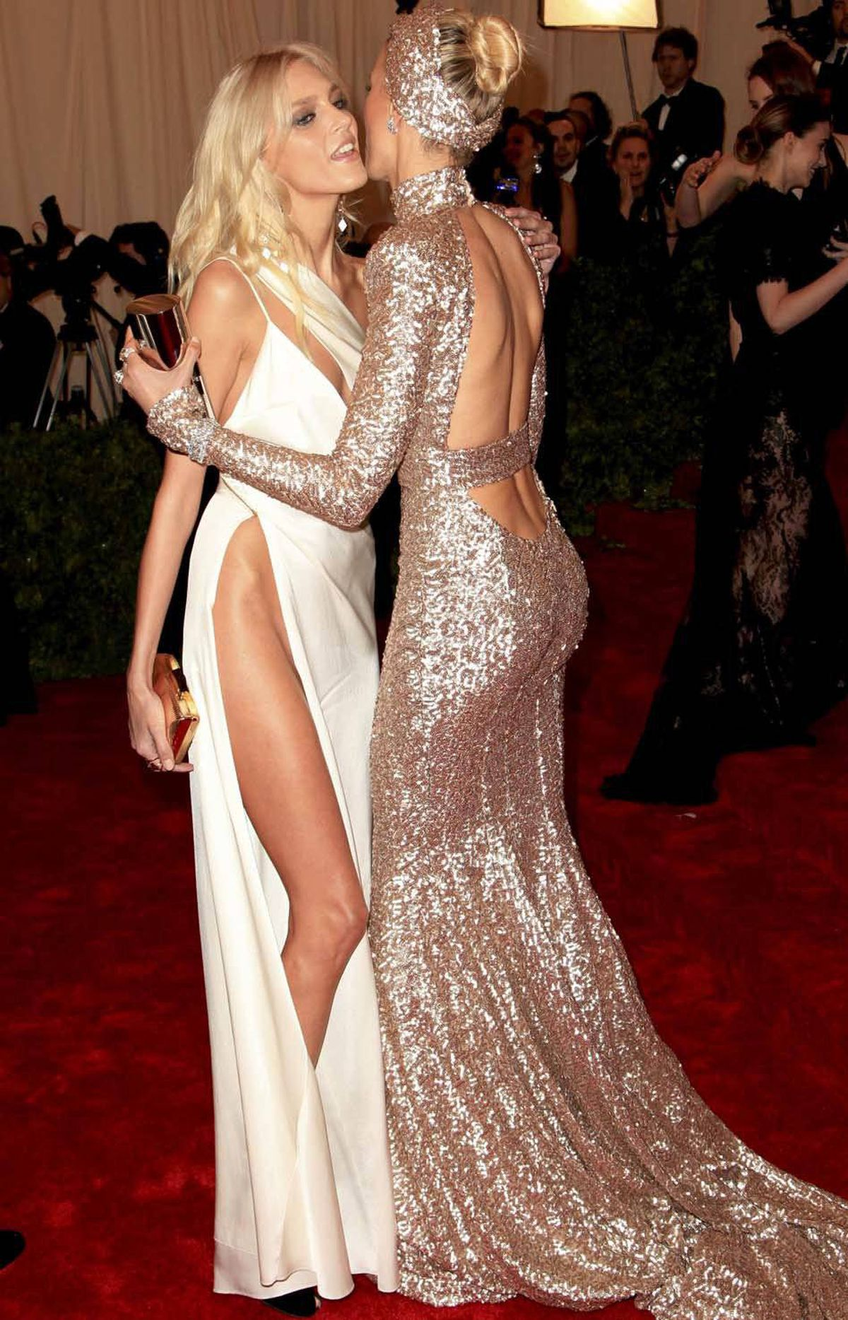 Karolina Kurkova (right) of greets fellow Polish model Anja Rubik at the Metropolitan Museum of Art Costume Institute Benefit in New York last week. There's something missing in this photo but I can't put my finger on it.