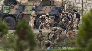 NATO and Afghan troops attend to casualties during a battle with Taliban insurgents who took over a building near the U.S. embassy in Kabul on Sept. 14, 2011. Ahmad Masood/Reuters