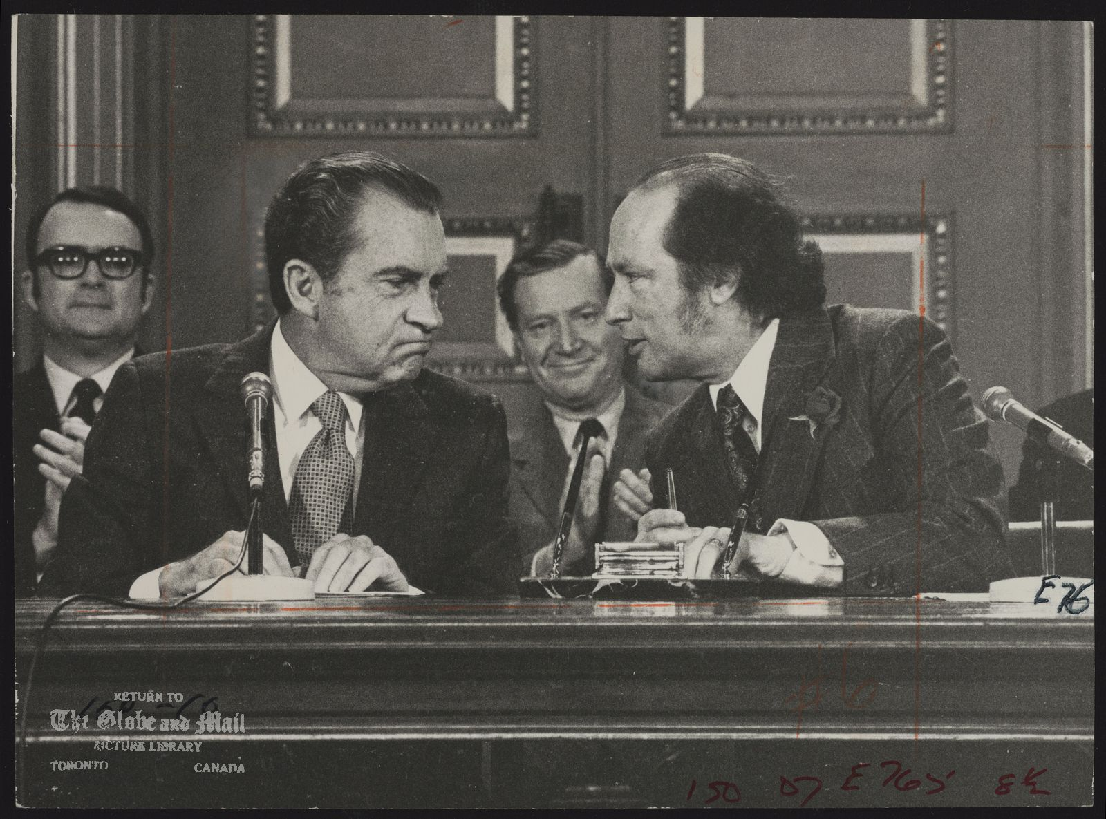 Richard NIXON Visit to Canada U.S.A. Politician (Nixon and Trudeau chat during the brief ceremony in the West Block of the Parliament Buildings prior to the signing of the Great Lakes Water Quality Agreement. U.S. environment official Russell Train is in the middle.)