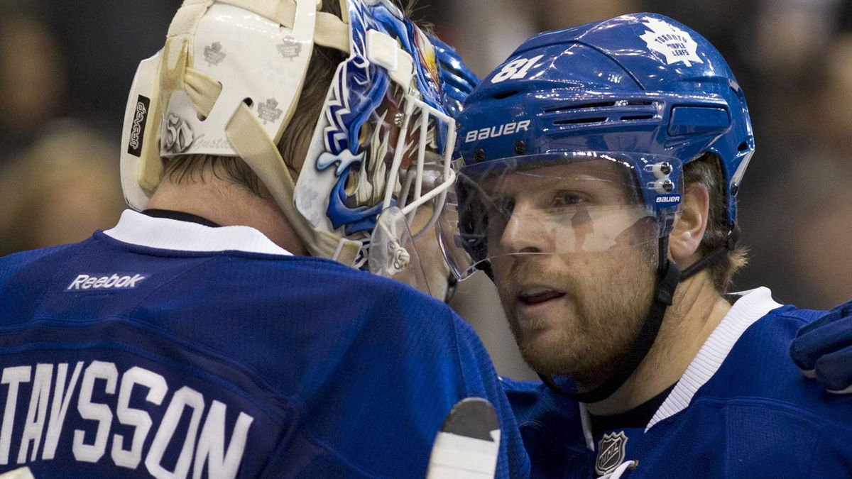 Toronto Maple Leafs right winger Phil Kessel (right) congratulates goaltender Jonas Gustavsson after they defeated the Detroit Red Wings 4-3 in NHL action in Toronto on Saturday January 7, 2012. THE CANADIAN PRESS/Frank Gunn