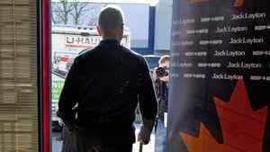 NDP Leader Jack Layton leaves a community centre during a campaign stop on April 7, 2011 in Vancouver.