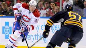 Buffalo Sabres defenceman Tyler Myers backs up as Montreal Canadiens left winger Andrei Kostitsyn moves the puck in Buffalo, Feb. 17, 2012.