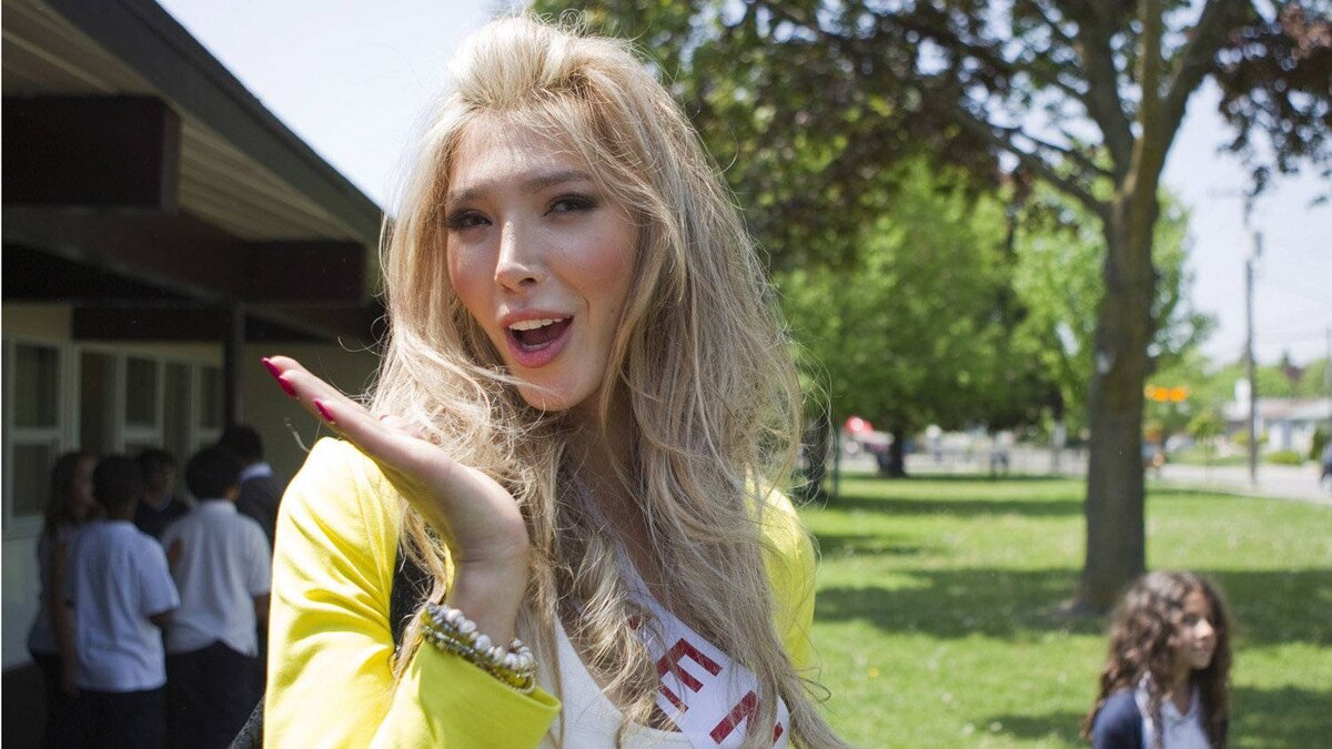 Transgendered beauty queen Jenna Talackova gestures outside the school as Miss Universe Canada contestants visit St. John Vianney Catholic School in Toronto on Tuesday May 15, 2012.