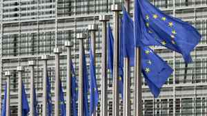 EU flags fly at European Commission headquarters in Brussels on May 9, 2011.