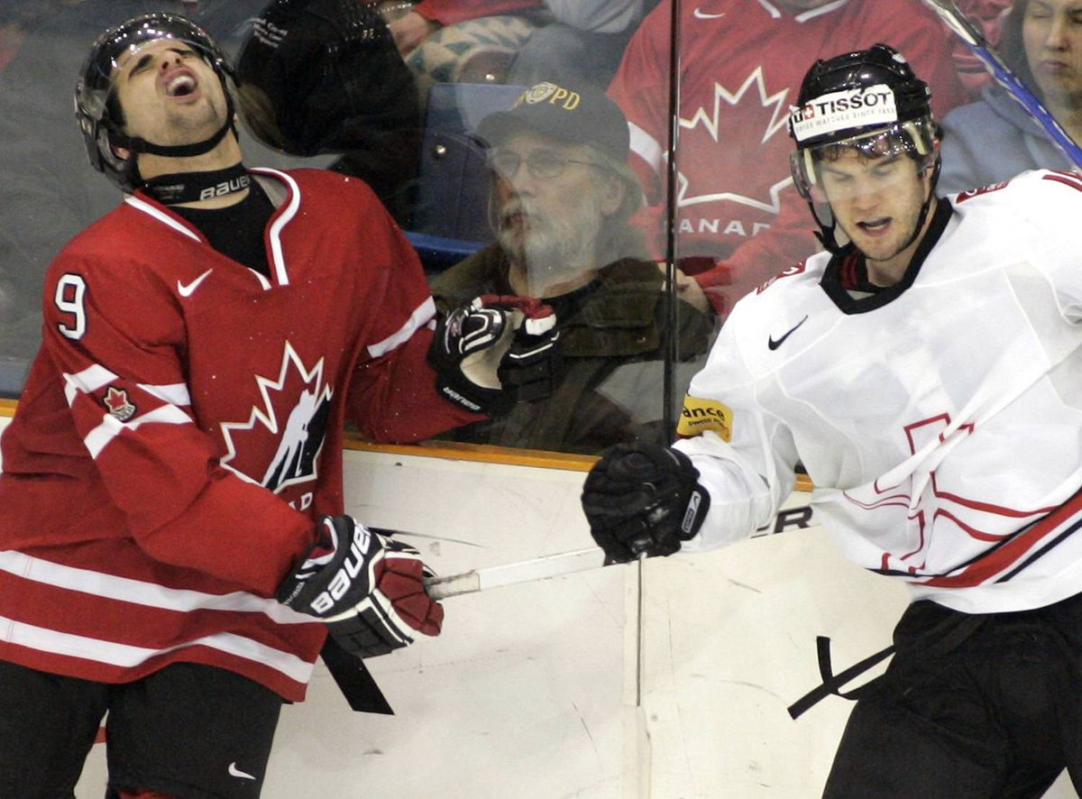 Team Canada's Nazem Kadri, left, reacts after being elbowed by Team Switzerland's Dominik Schlumpf during third period semifinal world junior hockey championship action in Saskatoon, Sask., Sunday, Jan. 3, 2010. Team Canada won by 6-1. THE CANADIAN PRESS/Geoff Howe