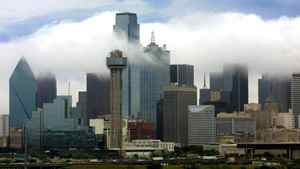 The Dallas skyline is shrouded in clouds
