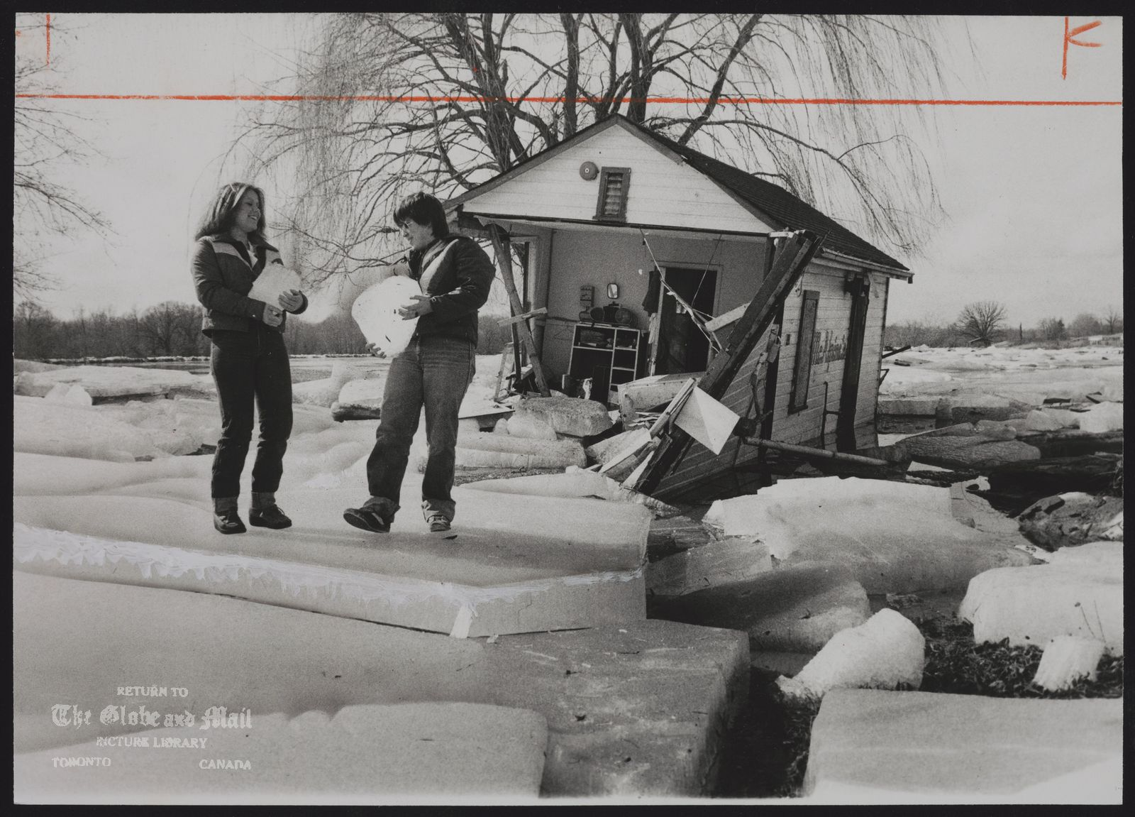 ICE Linda Guyatt (left) and Marian Jones of Caledonia, Ont., check ice damage to McAlpine's hamburger stand beside Highway 54, west of Caledonia. The stand was ripped open by ice left behind by floods from the Grand River.