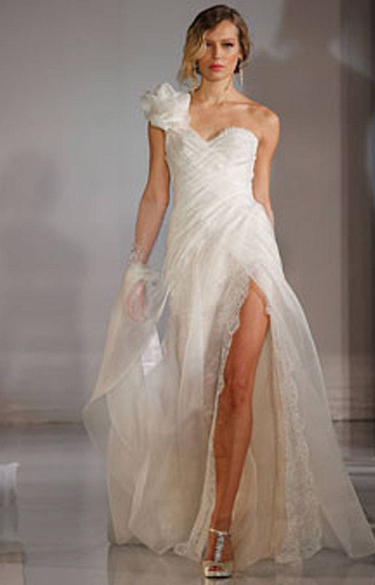 """SELLING SHORT Got great gams? This is the year to show them off, as shorter wedding gowns are also proving popular. Toronto designer Belter, who makes lacy minis, cites another reason for the new cropped hemlines: """"[They] allow brides to flaunt their killer shoes."""""""