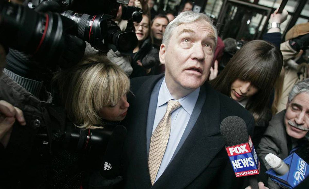Convicted newspaper baron Conrad Black leaves the federal building in Chicago Monday, Dec. 10, 2007, after sentencing in his racketeering and fraud trial. Black, convicted July 13 of swindling the Hollinger International newspaper empire he once ran out of millions of dollars, was sentenced to 78 months in prison.