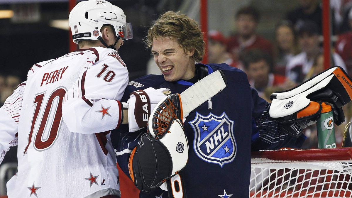 Anaheim Ducks' Corey Perry (L) of Team Staal and Anaheim Ducks goalie Jonas Hiller of Team Lidstrom joke during the second period of the NHL All-Star hockey game in Raleigh, North Carolina January 30, 2011. REUTERS/Ellen Ozier