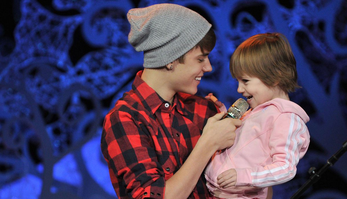 Justin Bieber and his sister Jazmyn perform during a special acoustic Christmas show at Massey Hall in Toronto.