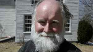 Novelist Nicholson Baker poses outside his home in Berwick, Maine, on Monday, April 7, 2008.