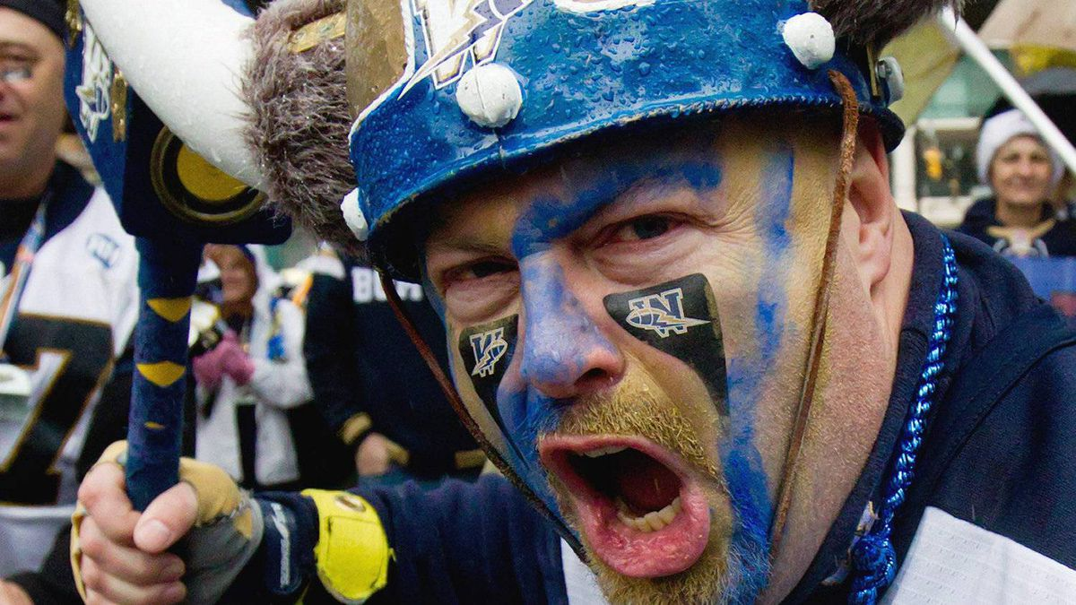 Winnipeg Blue Bombers' fan Ken Burns, of Winnipeg, Man., participates in the Grey Cup parade in Vancouver, B.C., on Saturday November 26, 2011. The Winnipeg Blue Bombers and B.C. Lions are scheduled to play in the Canadian Football League's 99th Grey Cup Sunday in Vancouver. THE CANADIAN PRESS/Darryl Dyck