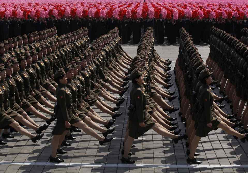 In an April 15, 2012 photo, North Korean soldiers attend a mass military parade in Pyongyang's Kim Il Sung Square to celebrate 100 years since the birth of the North Korean founder Kim Il Sung. The spectacles exist at a North Korean intersection of dogma, tedium and entertainment.