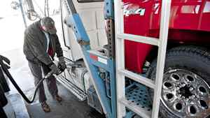 Truck driver Don Pamateer fills his truck with diesel fuel at a Pilot Travel Center in Princeton, Illinois, March 5, 2012. Economist Philip Verleger Jr. expects the U.S. to be able to meet all of its own energy needs by 2023.